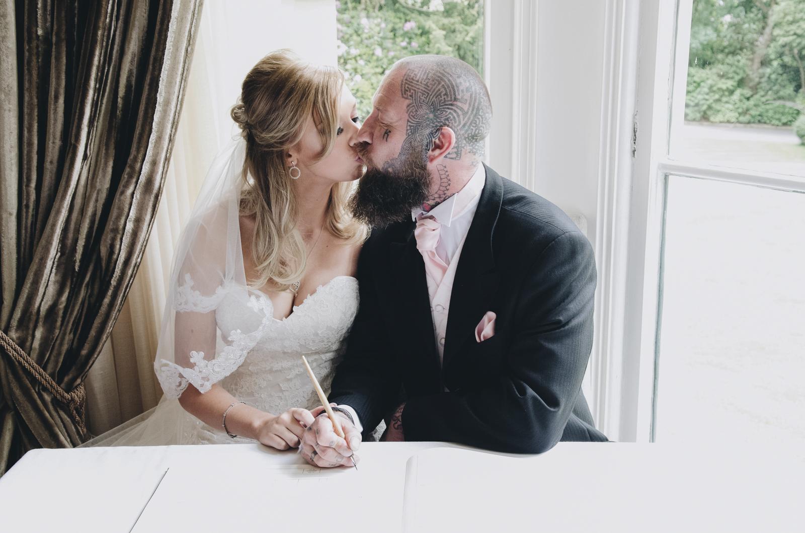 Alternative-North-West-Manchester-Wedding-Photography-Astley-bank-Wedding-skull-cake-tattooed-groom-13.jpg