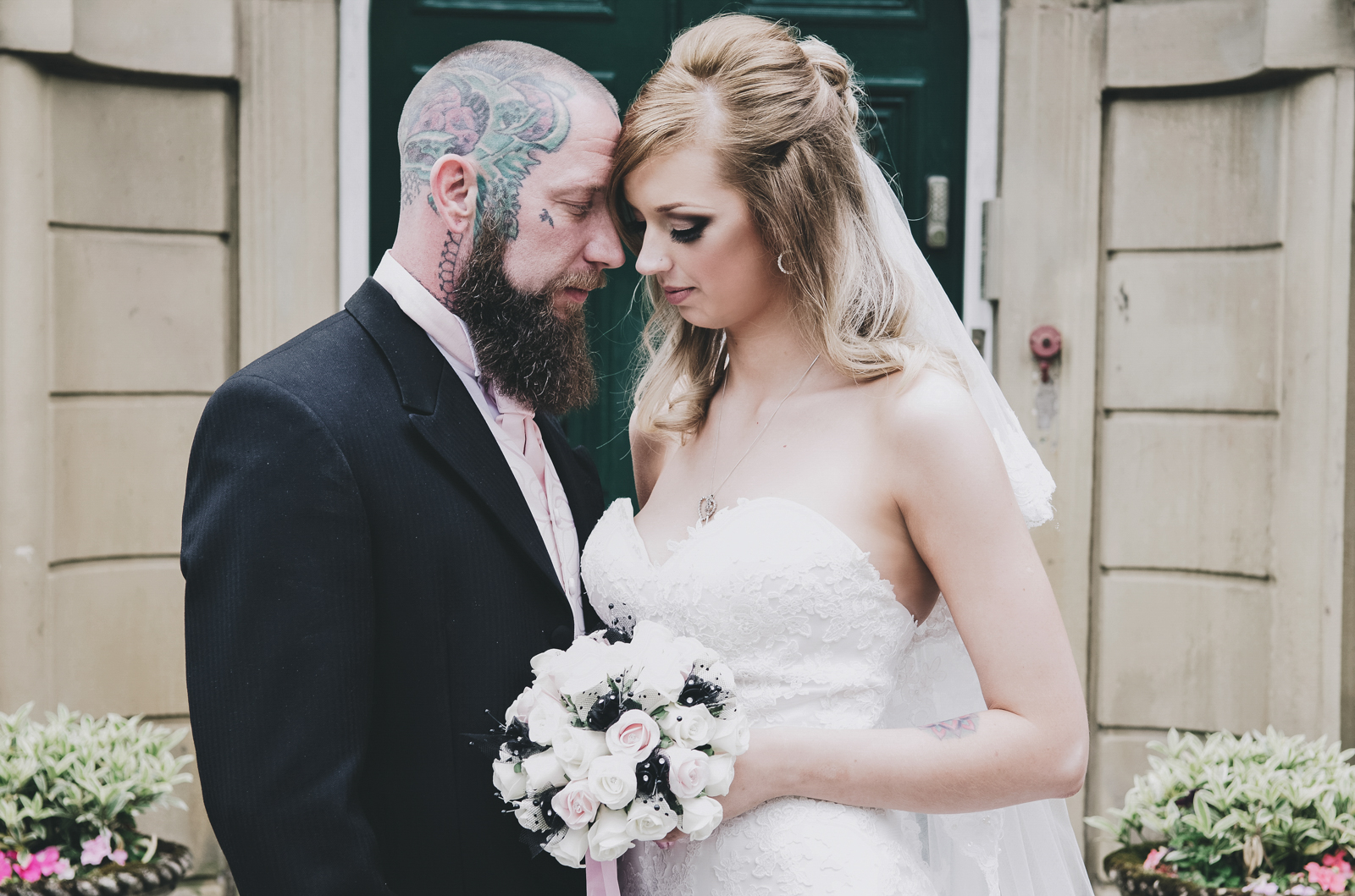 Alternative-North-West-Manchester-Wedding-Photography-Astley-bank-Wedding-skull-cake-tattooed-groom-19.jpg