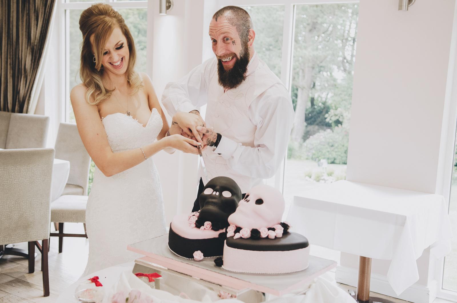 Alternative-North-West-Manchester-Wedding-Photography-Astley-bank-Wedding-skull-cake-tattooed-groom-36.jpg