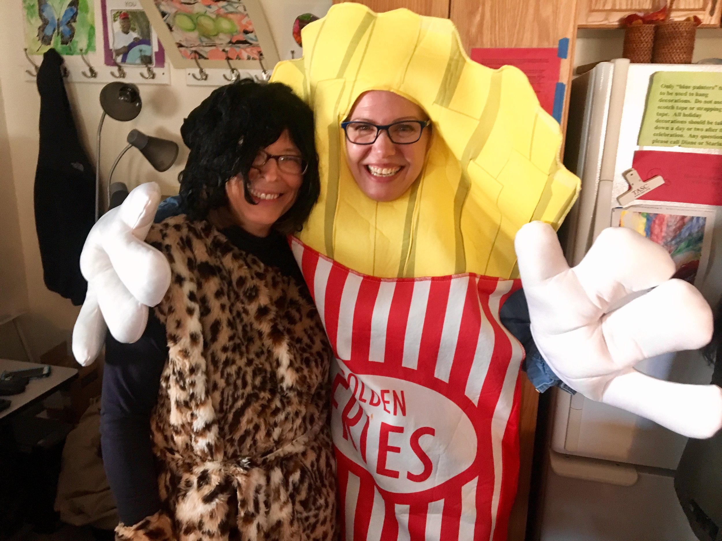 (Left) Impact's Accounting Manager Mary Ann Kearns and (Right) Chief Development Officer, Dena Malikowski pose in their Halloween costumes