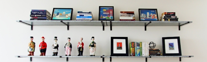 The upper two shelves allow the client's books and city artwork to shine. More on the bar men in the next photo...
