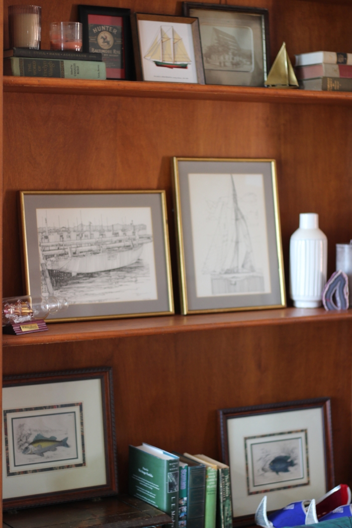 A view of a couple of the ship-themed shelves, including shoes from an Indian wedding.