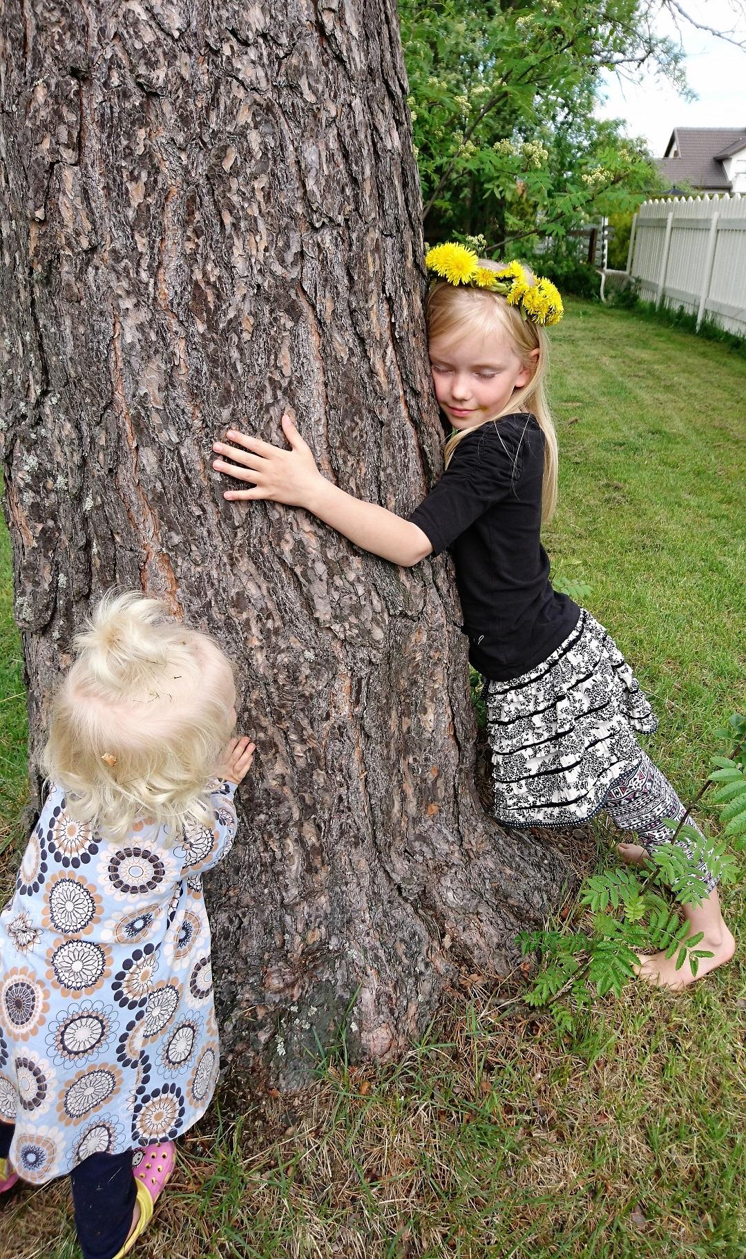 Lumi and Kukka with THAT tree