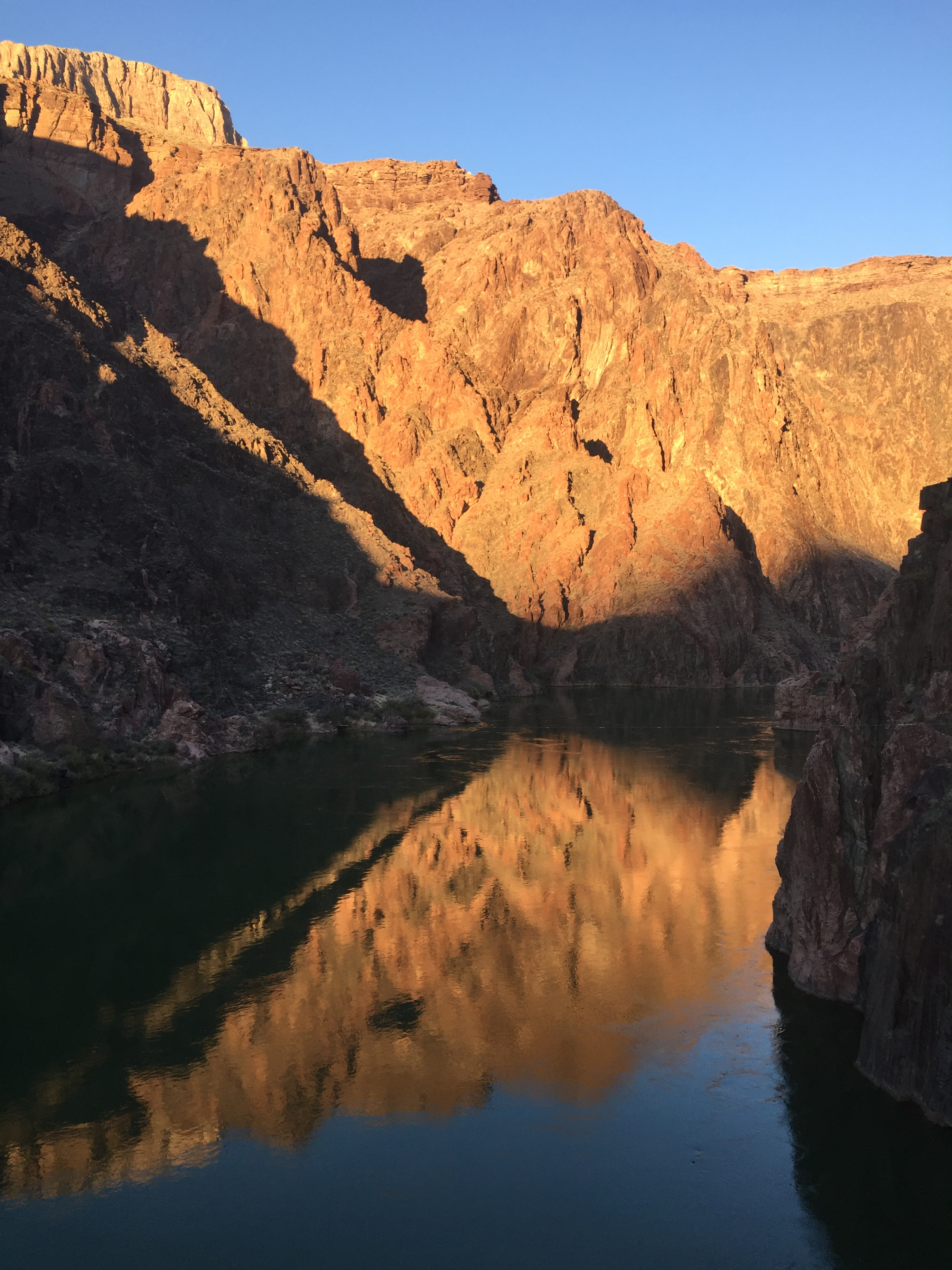 The canyon reflecting in the Colorado River at sunset