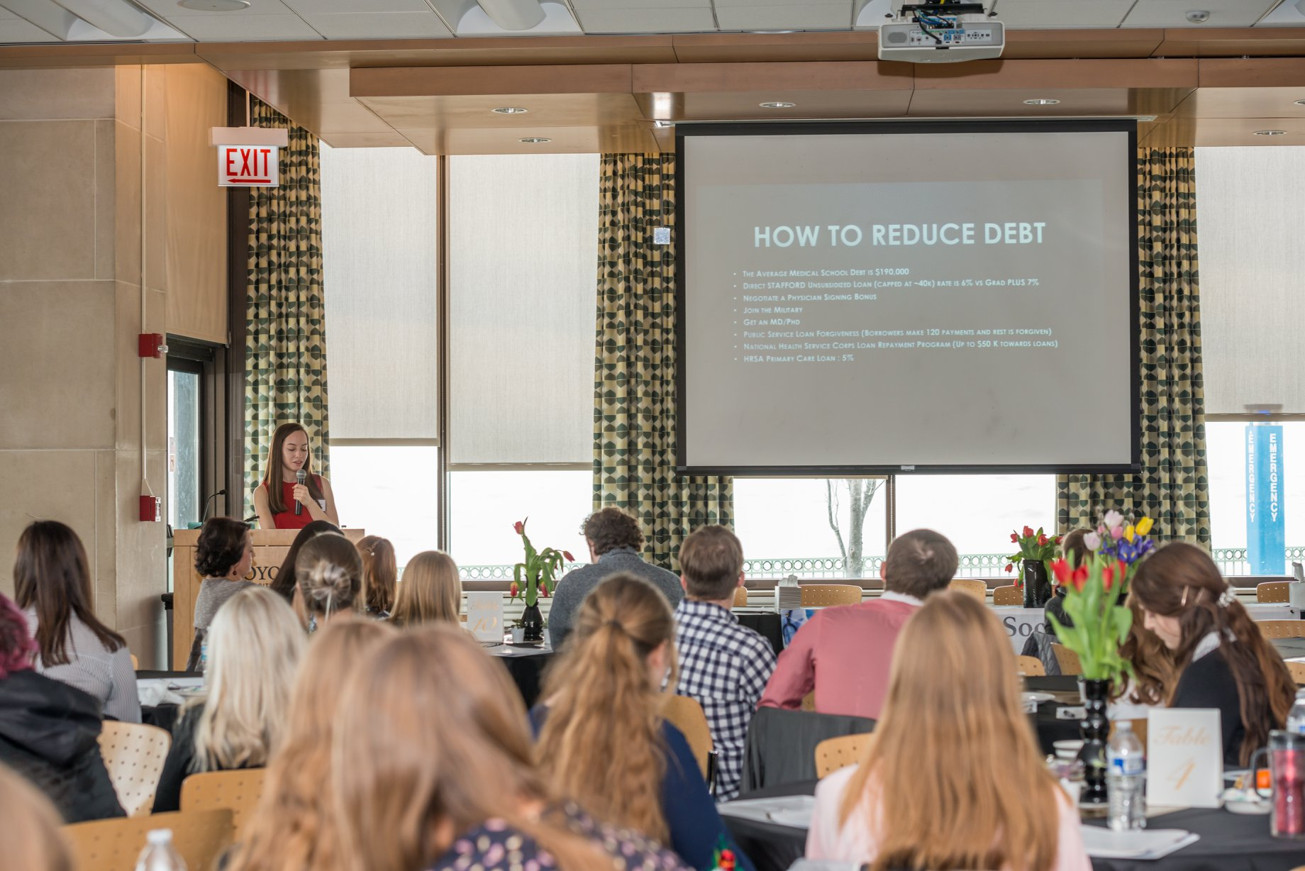Elizabeth Zborek helps participants navigate through loans, financial success, and scholarships.