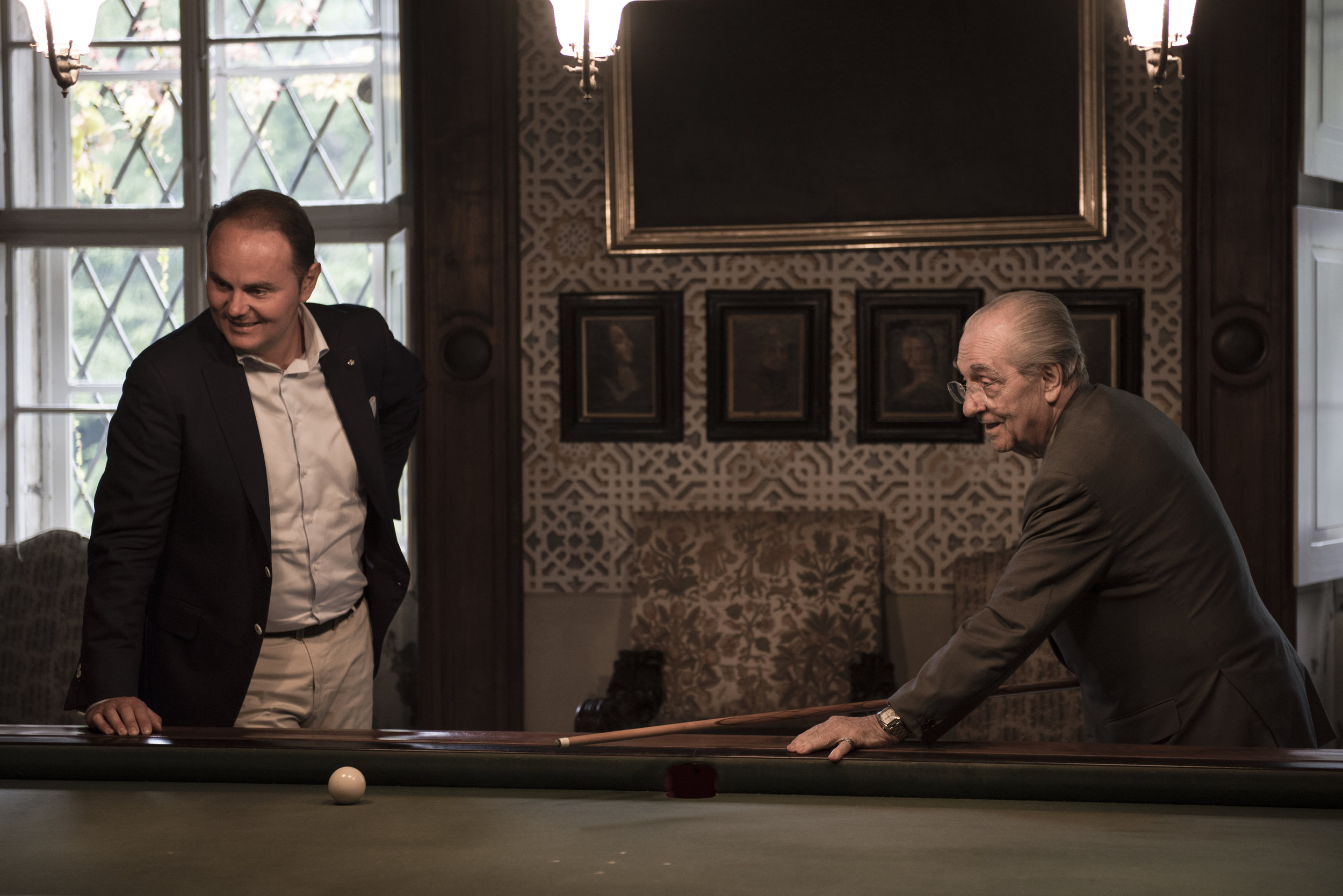 Marchesi shooting pool, in a still from the movie