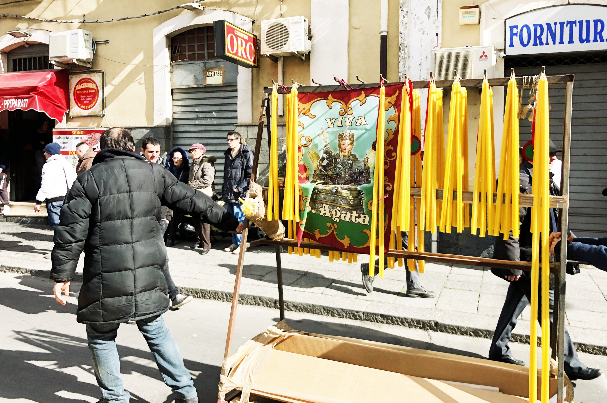 Vendors sell 2 euro candles to give to the saint