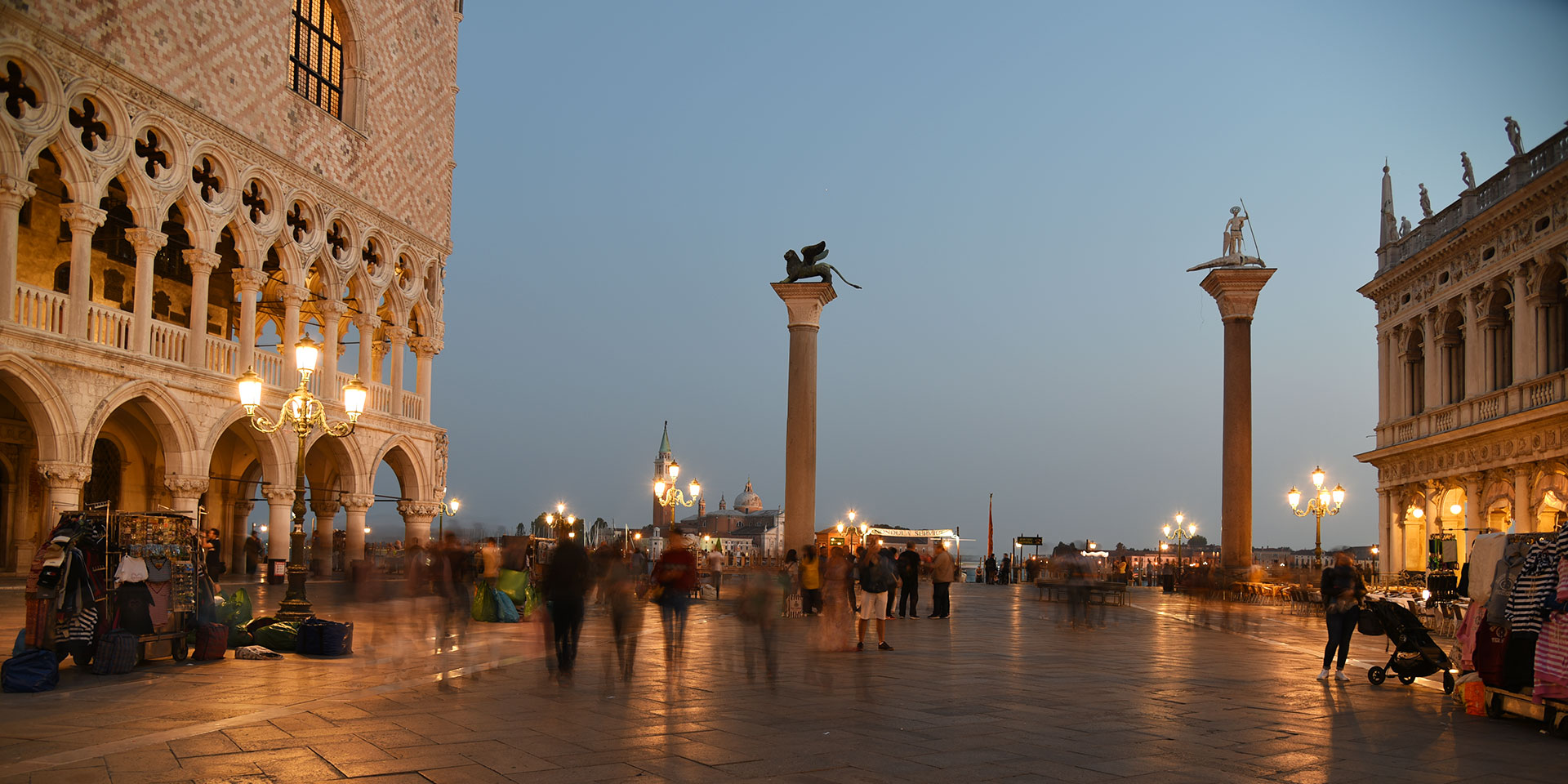 Walk by the columns of San Marco and San Todaro — but not between them. (Photo: Getty Images)