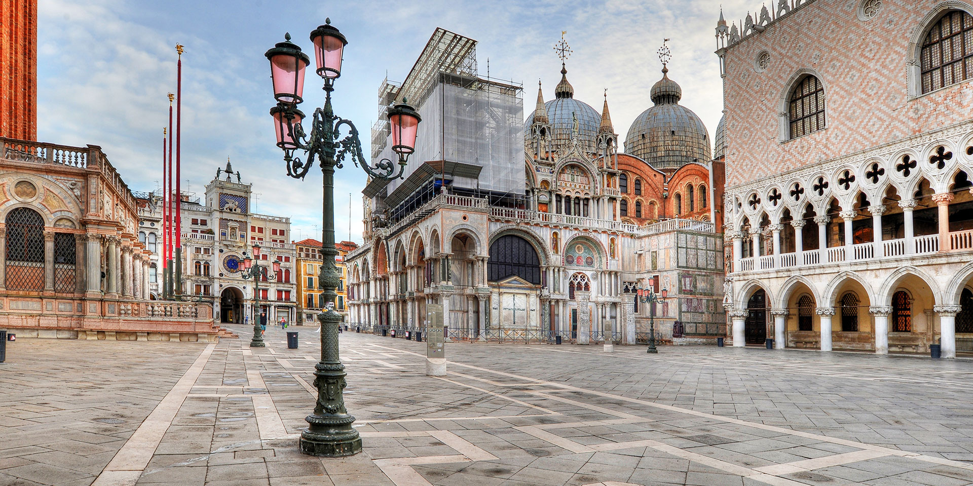 Make like Bond and dash through the Piazza San Marco. (Photo: Getty Images)