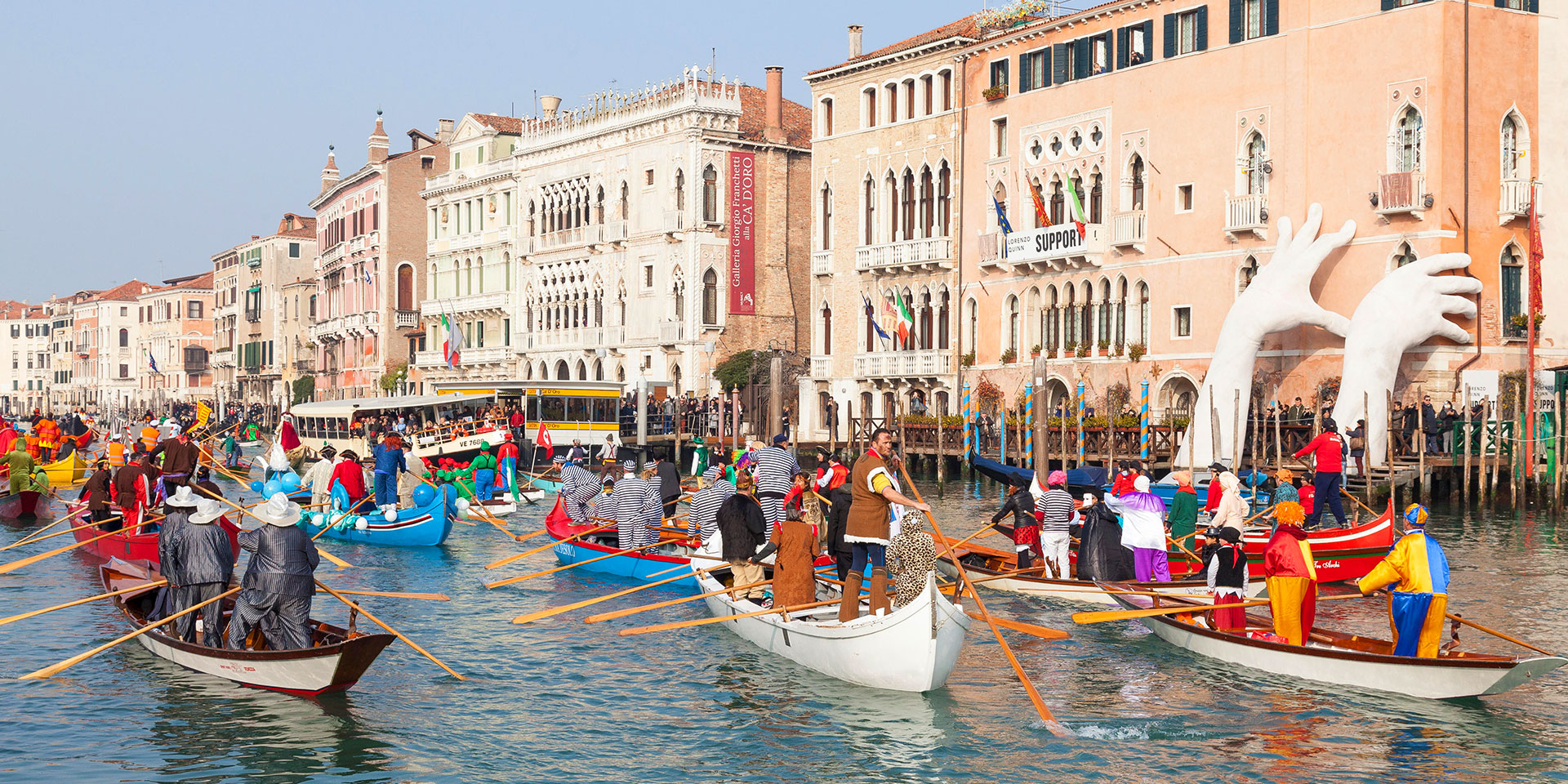 Watch as locals the open water in colorful costume. (Photo: Alamy)