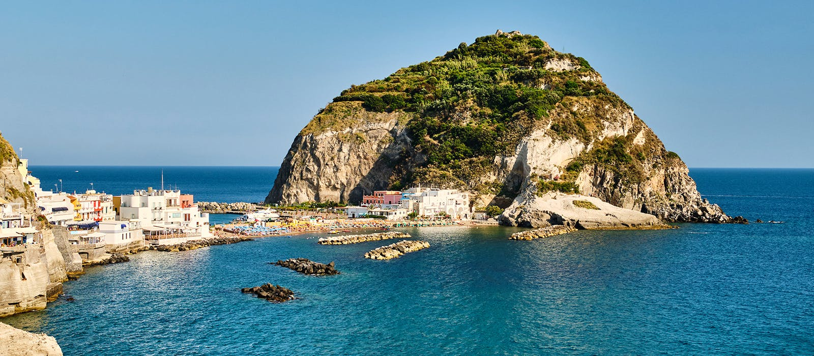 Fortified castles atop craggy outcroppings? Check. Blue coves? Check. Colorful village? Check. Italian islands (like Ischia above) have charm on lockdown.  Photo by Jan Mach/Shutterstock