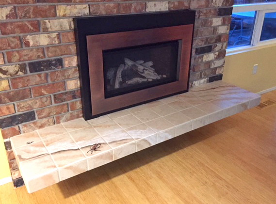 Beach Hearth. This very subtle hearth design was created to cover up a stained and chipped concrete slab hearth. It simulates wave patterns on sand.