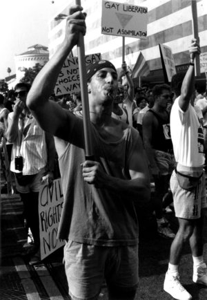Outraged by Gov. Pete Wilson's veto of a gay rights bill that would have outlawed job descrimination on the basis of sexual orientation. Timm constructed a banner the night before a protest march and unexpectedly found himself in the front of a sea of thousands who marched down Wilshire Blvd.