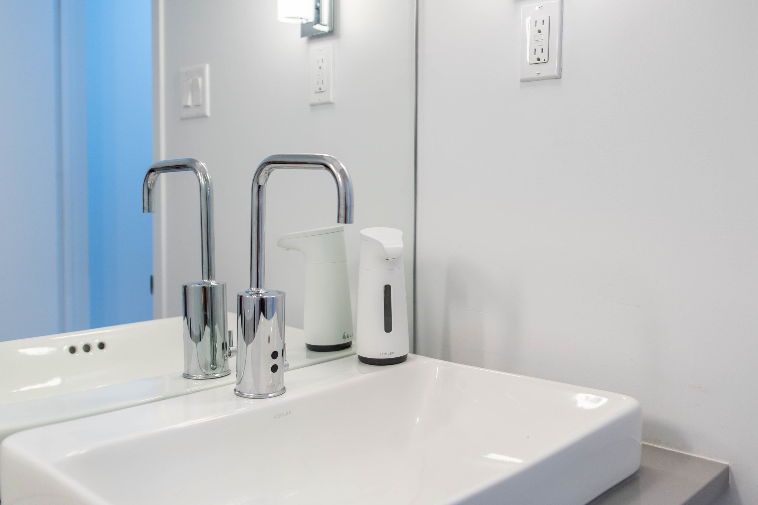 Kohler Touchless Faucet and Soap Dispenser - Automatic taps contribute to a more sustainable world in two main ways: