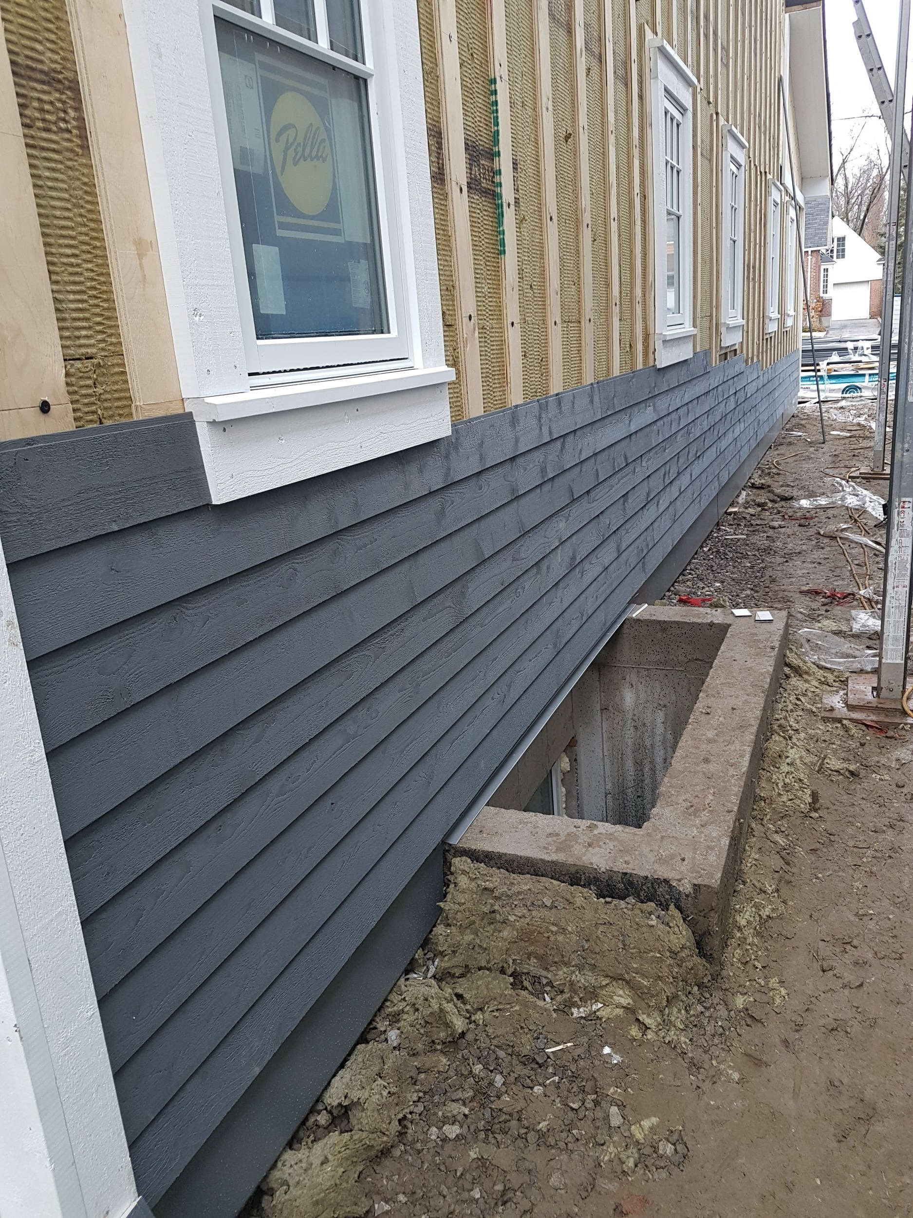 Wood siding over exterior mineral wool insulation.