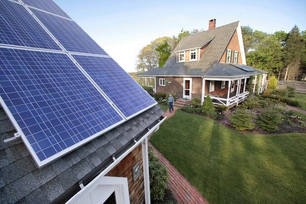 Outfitting a house with solar energy panels is one step towards creating a net-zero energy building.    STEPHAN SAVOIA/ASSOCIATED PRESS