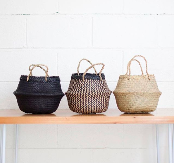 Fair-trade basket  handwoven Vietnam weavers with natural materials and a quiet, simple beauty from  Xinh & Co . Use yours a storage basket or to display new plant baby.