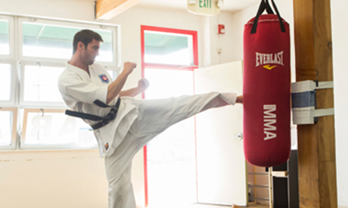 SENSEIAUSTIN GREENE - Sandan / 3rd DanSensei Austin grew up in Manhattan Beach, CA and has been training with Koshiki Karate-Do since 1996. He has 24 years of Martial Art experience with the styles of Kenpo and Shorin-Ryu. He has been named the California State, National and World Koshiki Karate Champion and has competed multiple times on American Ninja Warrior.In addition to 24 years of martial arts experience, Austin works full time as an Art Director with a digital creative agency, and enjoys spending time with his girlfriend family and friends. During the summer you might see him riding his bike down on the strand.