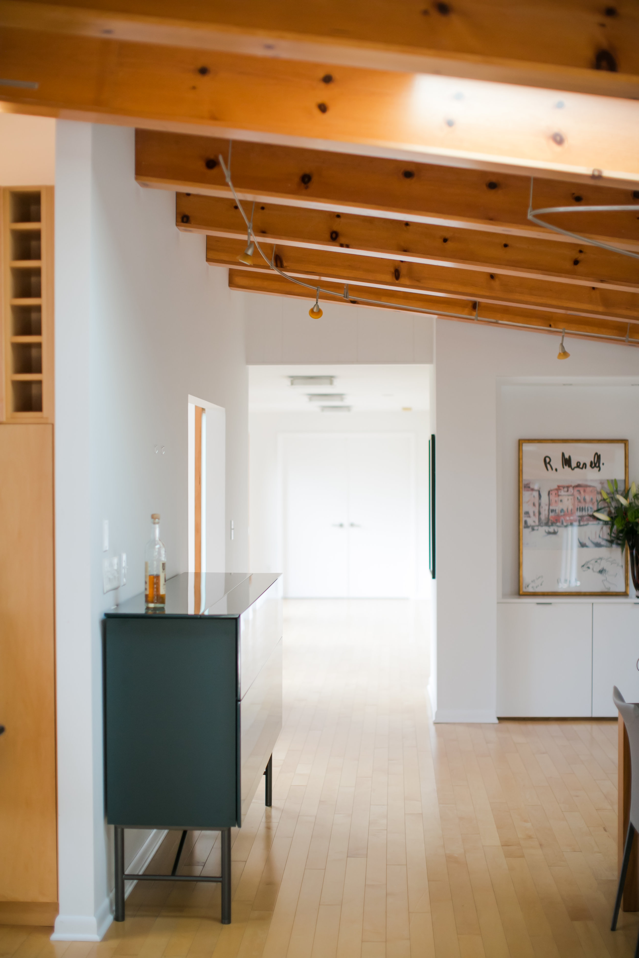 Photo demonstrates the light and bright nature of the original main living space of the home.