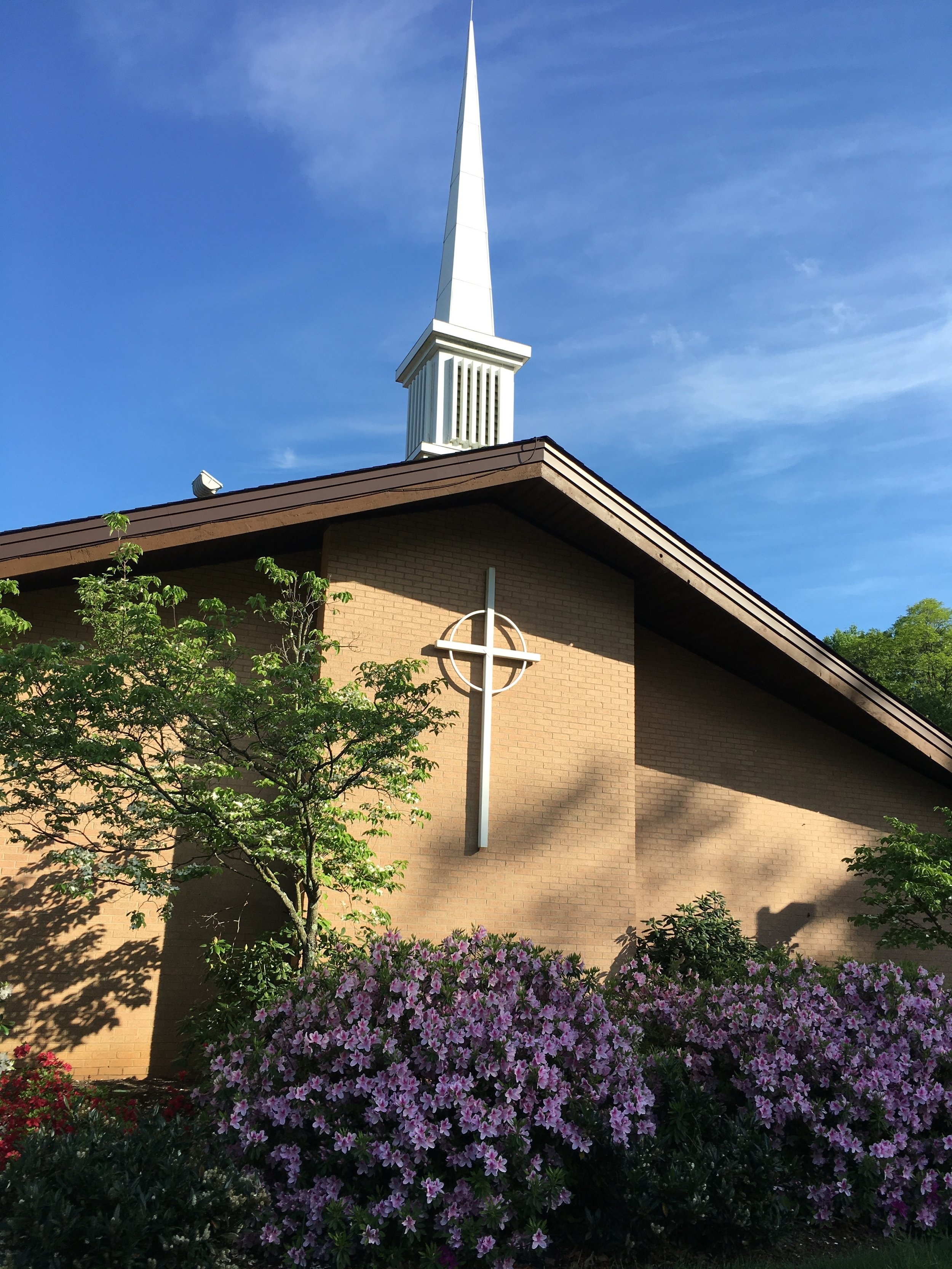 Church cross and flowers.JPG