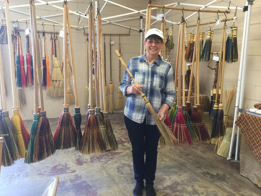 Look at all those beautiful brooms behind me!