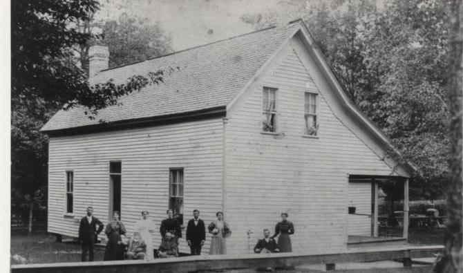 Here's the Baucom homestead. My great grandmother is dressed in white and standing behind her father, Josiah Baucom. Grandma Baucom (my great-great grandmother, Joan Walker Baucom) is seated to his left.