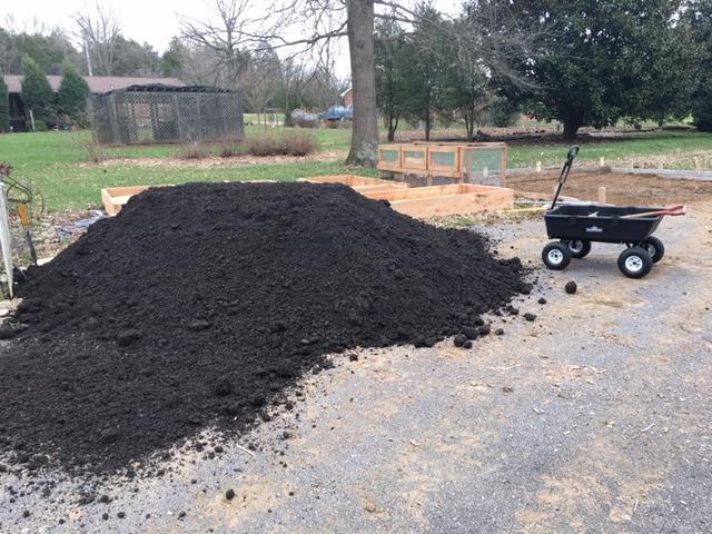garden soil on driveway.JPG