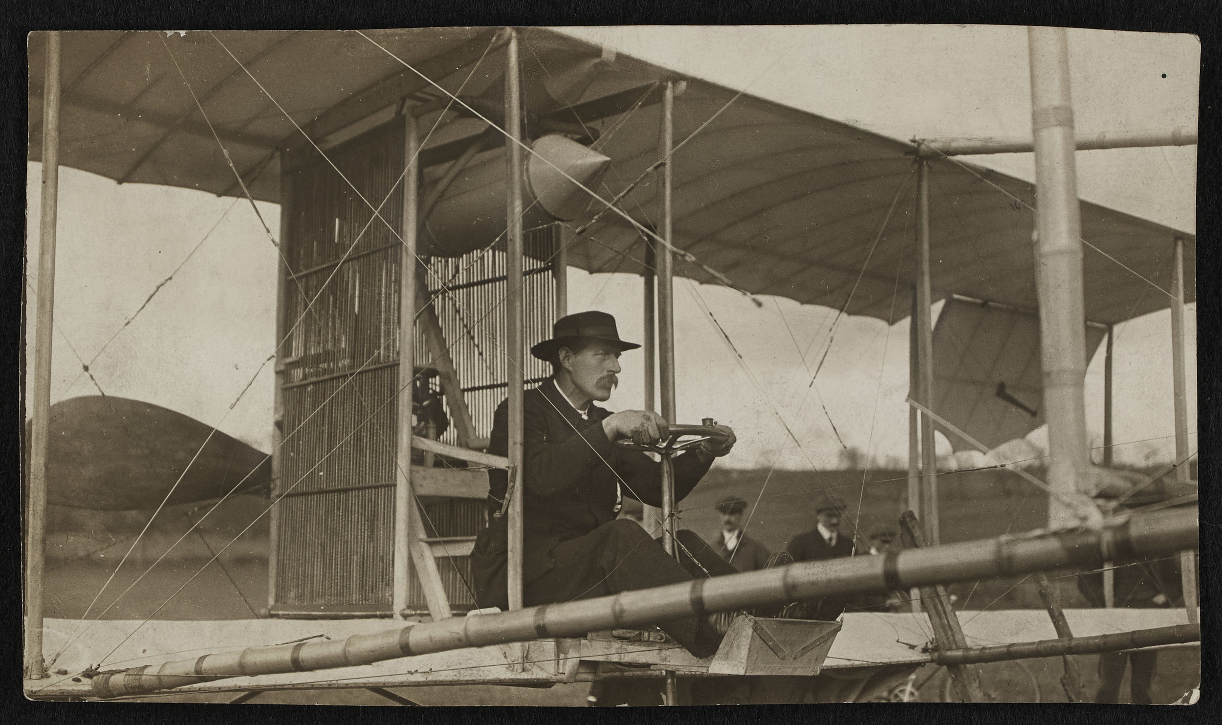 Revd Sidney Swann at the controls of his home-made flying machine