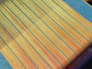 hand woven fabric, painted warp