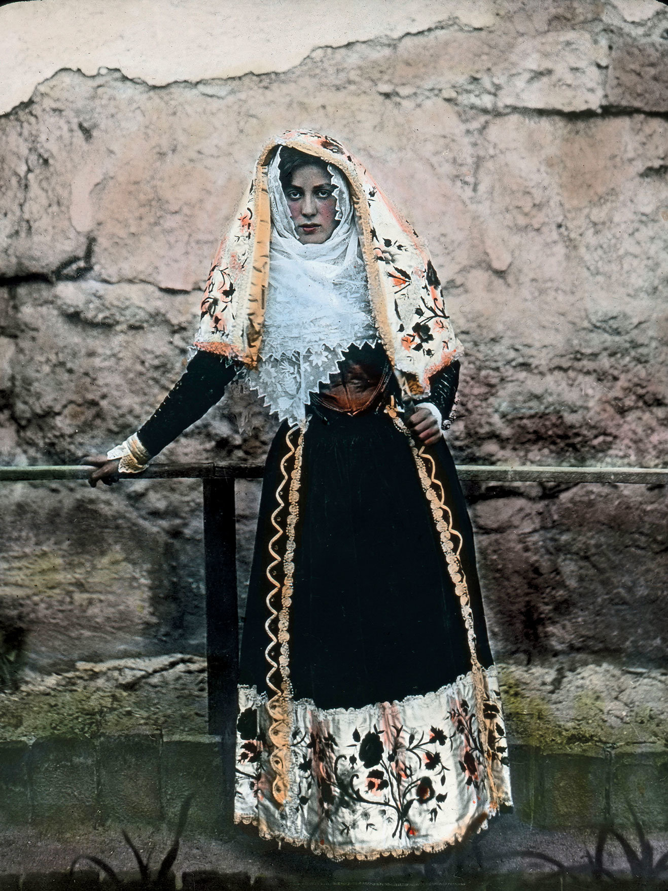 A Sardinian woman from around 1910 dressed in decorative clothing native to the island. The patterns and style of dress are specific to each town. Traditional Sardinian weavings are patterned with small raised bumps of thread, called pibiones. Credit United Archives/Carl Simon/Granger