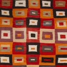 Navajo Transitional textile, c. 1890, Handspun wool, aniline dye, 70 x 54 1/4 inches. Collection of Carol Ann Mackay
