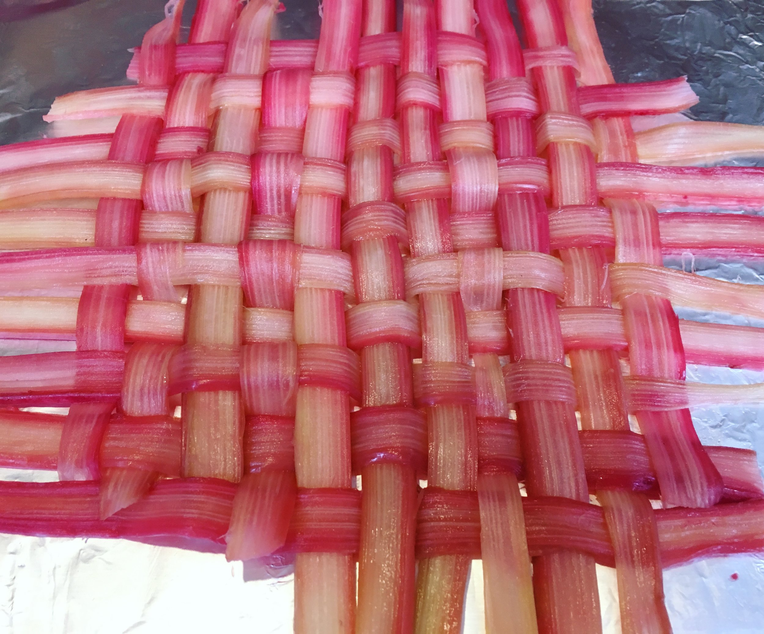 Woven rhubarb prepped on foil.