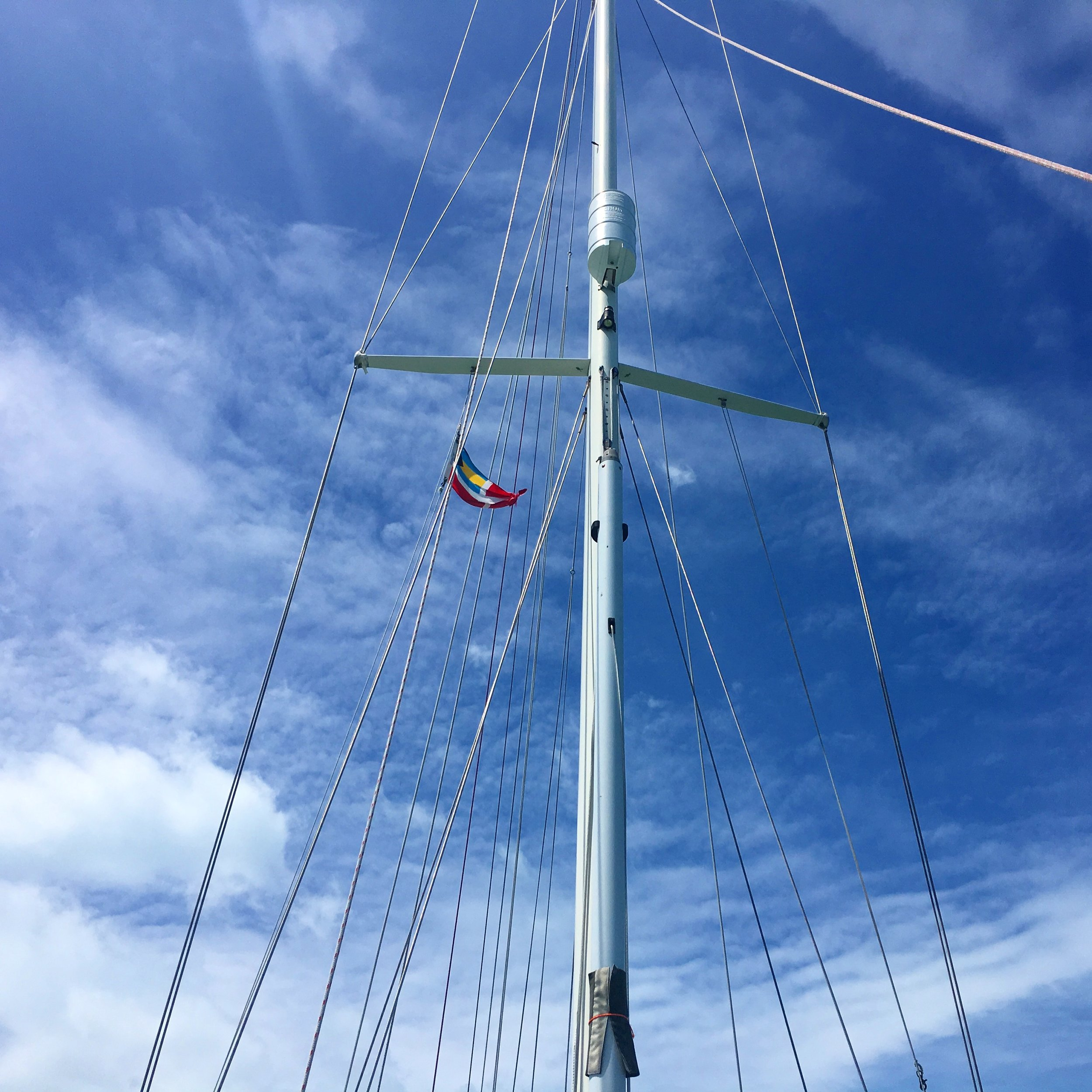 Our tattered Bahamas flag on the starboard spreader.