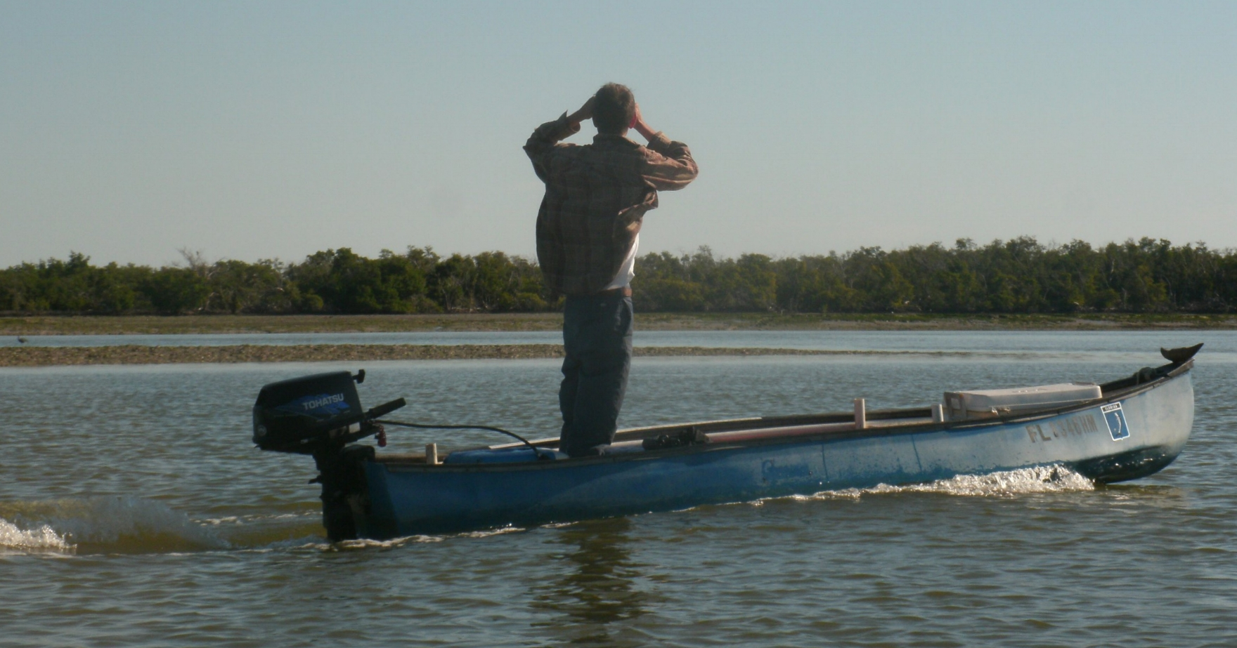Jimi Sadle scanning the horizon for flamingoes in Lake Ingraham