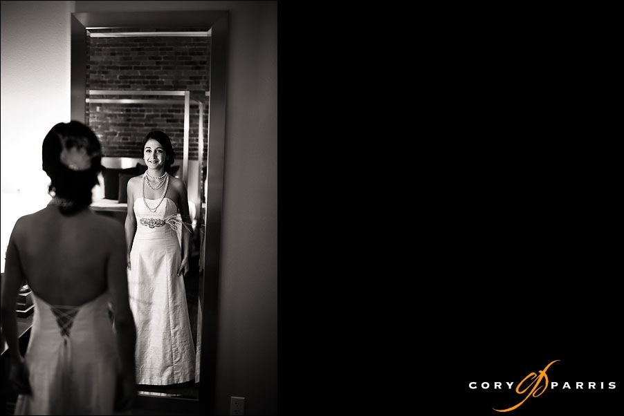 bride looking at herself in mirror by seattle wedding photographer cory parris