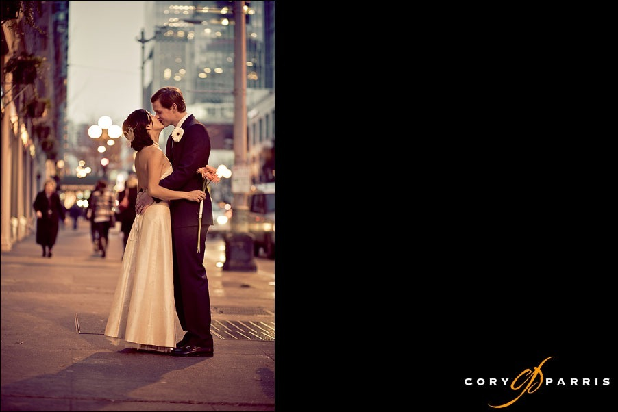bride and groom kissing on the seattle street on a winter night by seattle wedding photographer cory parris
