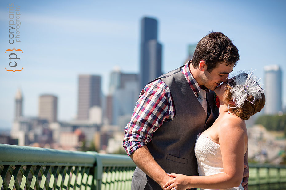 bride and groom weddiing portrait with view of Seattle in the background