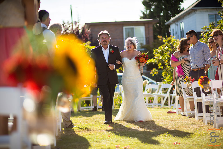 bride and groom walking down the aisle at the beacon hill garden house wedding venue in Seattle