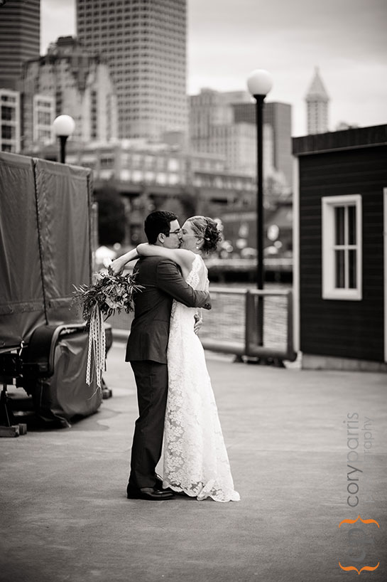 bride and groom kissing after their wedding