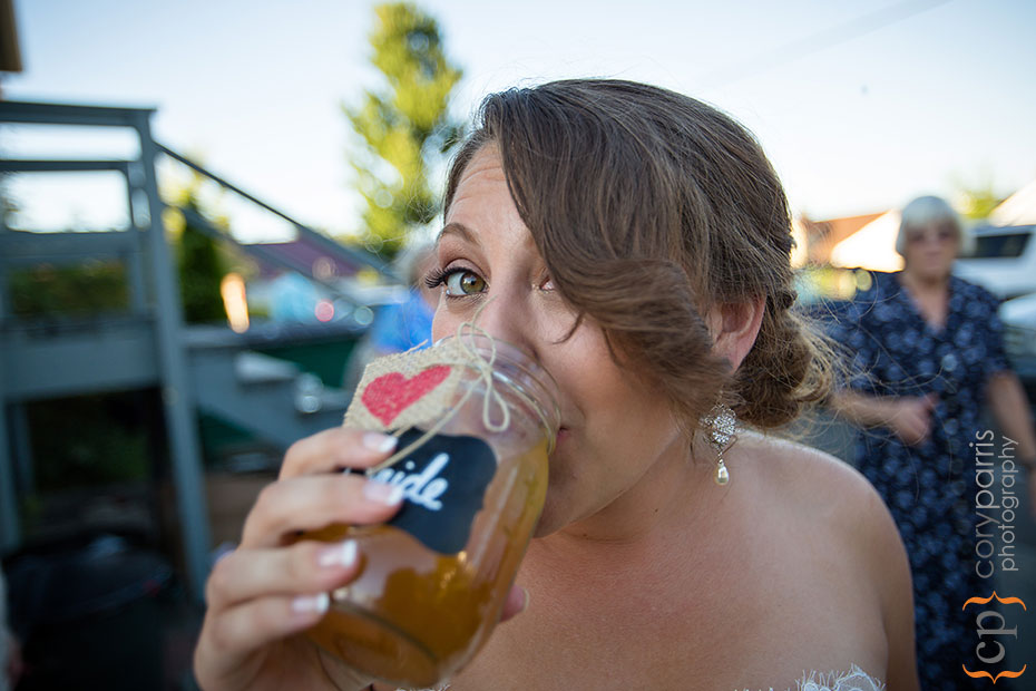 bride drinking out of a mason jar