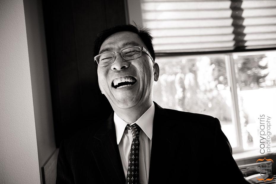 man laughing at tea ceremony