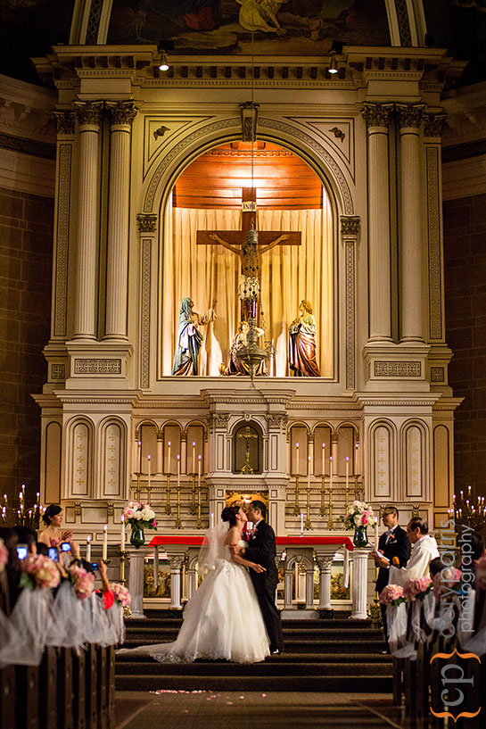 first kiss at immaculate Conception wedding