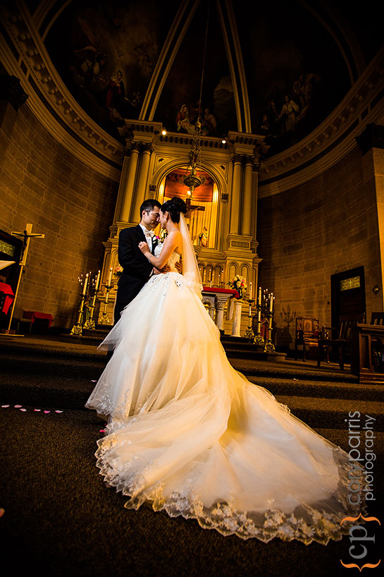 Monica and Jimmy portrait at the altar at Immaculate Conception