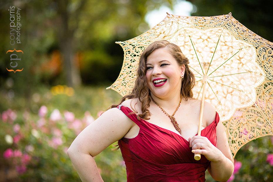 bride portrait in red dress with umbrella
