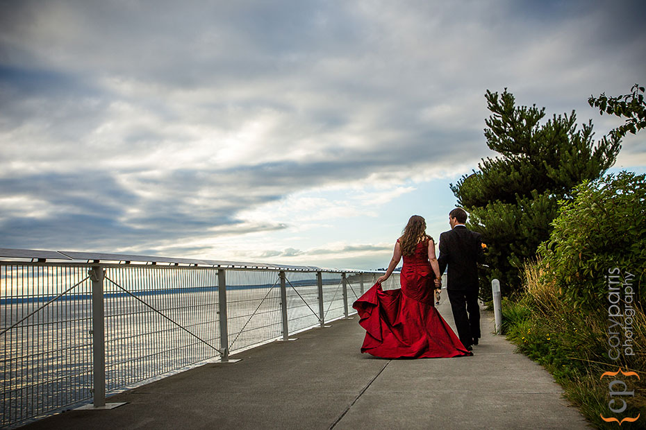 bride and groom walking along the seattle waterfront