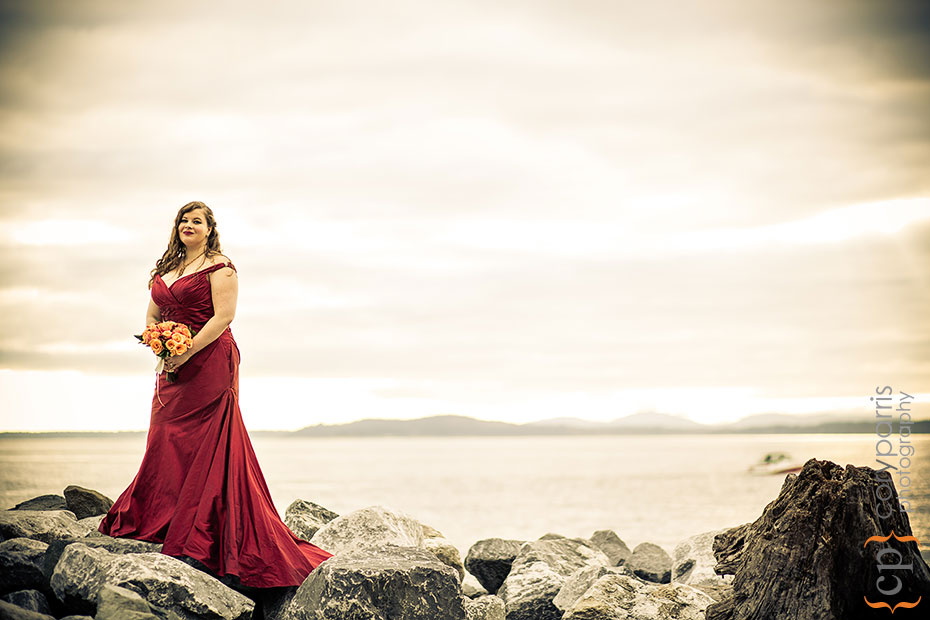 bride in a red dress on the waterfront
