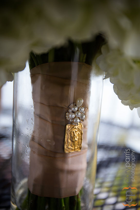 gold charm on wedding bouquet