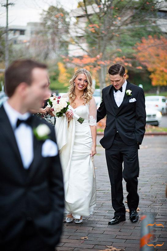 bride and groom walking at Gas Works Park