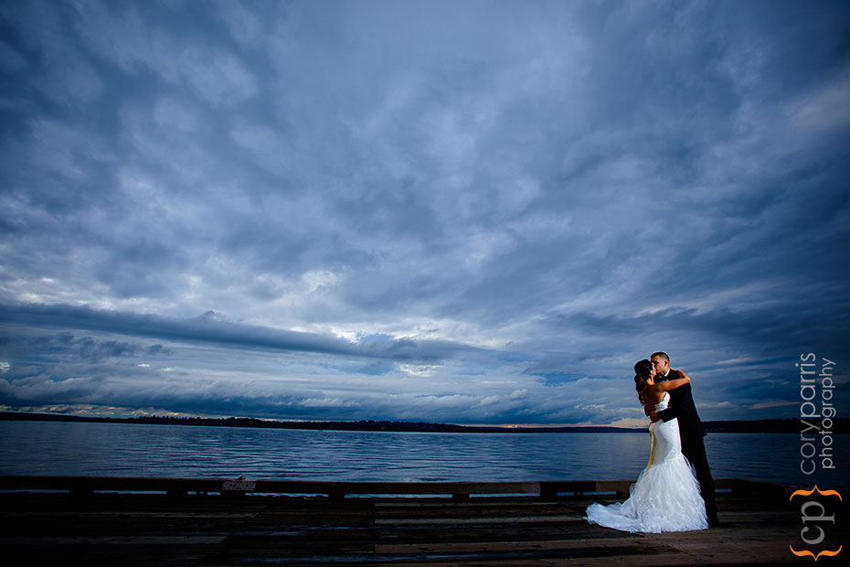 bride and groom on a dock by Woodmark Hotel using strobist techniqes
