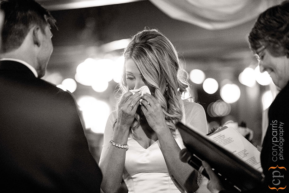 bride crying during wedding ceremony at Lake Union Cafe